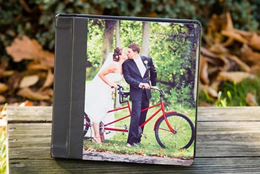 wedding album with the bride and groom on a bicycle